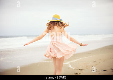 Rear view of teenage girl strolling on beach, Hampton, New Hampshire, USA - Stock Photo