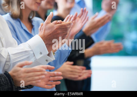 Cropped image of hands clapping - Stock Photo