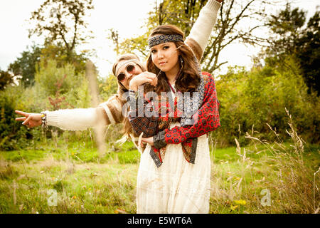 Hippy girls in a field - Stock Photo