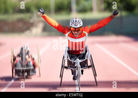 Athlete at finishing line in para-athletic competition - Stock Photo