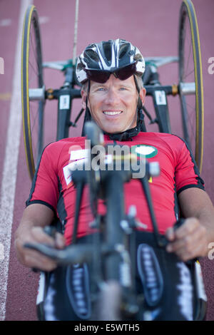 Close up of cyclist in para-athletic training - Stock Photo