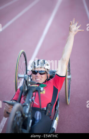 Cyclist at finishing line in para-athletic competition - Stock Photo