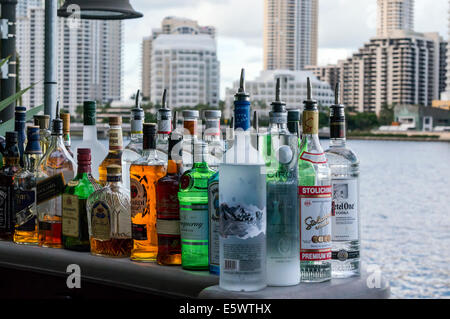 Liquor bottles sit on the patio bar of Crazy About You restaurant on Biscayne Bay in Brickell area of Miami, Florida. - Stock Photo