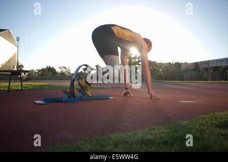 Sprinter in start position - Stock Photo