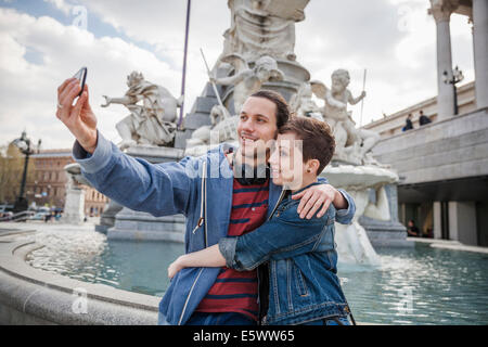 Young adult couple taking picture of themselves, Vienna, Austria - Stock Photo