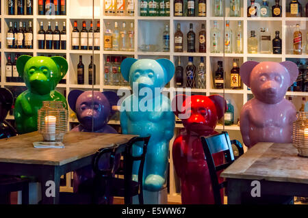 Colorful ceramic bears guard the wine and liquor cellar of the Brickell Miami restaurant, Crazy About You on Biscayne - Stock Photo