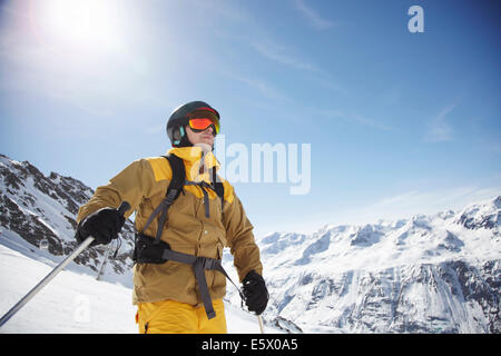 Low angle view of mid adult male skier on mountain, Austria - Stock Photo