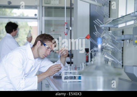 Male and female scientists working in lab - Stock Photo