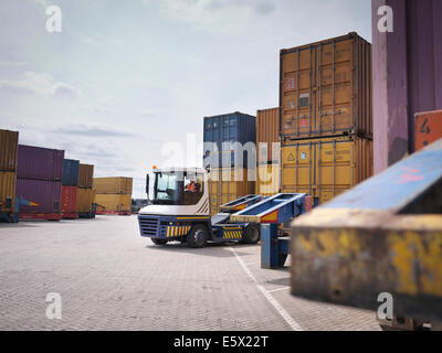 Shipping containers and truck in port - Stock Photo