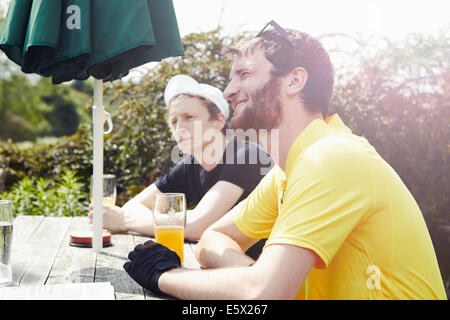Cyclists in beer garden in pub - Stock Photo