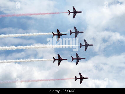 Red Arrows in formation over Bournemouth Pier - Stock Photo