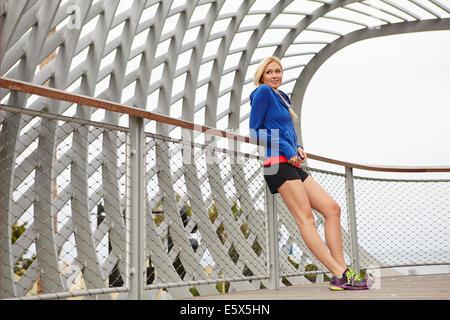 Woman resting against fence, Tongva Park, Santa Monica, California, USA - Stock Photo