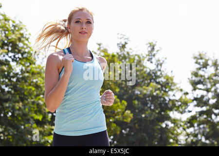Woman running in park - Stock Photo