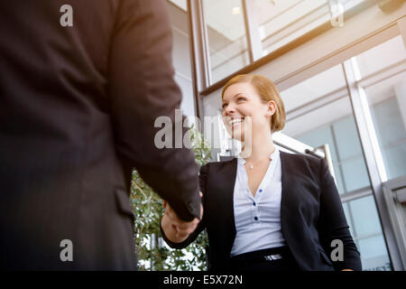 Businesswoman meeting client in office - Stock Photo