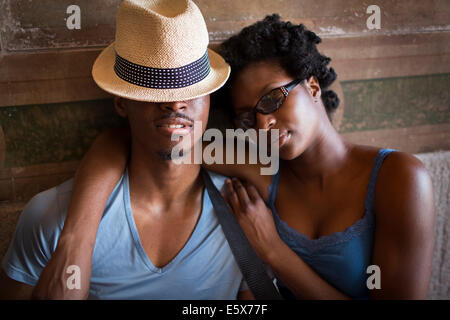 Young couple with eyes closed in Bethesda Terrace arcade, Central Park, New York City, USA - Stock Photo