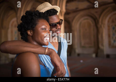 Young couple strolling in Bethesda Terrace arcade, Central Park, New York City, USA - Stock Photo