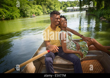 Young couple on rowing lake in Central Park, New York City, USA - Stock Photo