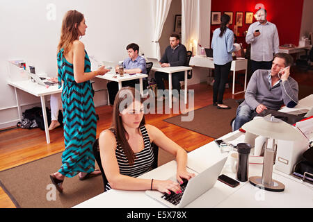 People at work in busy modern office space - Stock Photo
