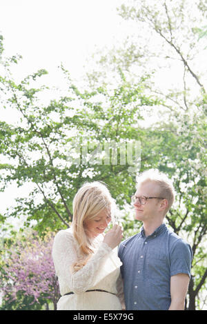 Young couple in park - Stock Photo