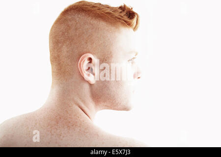 Rear view studio portrait of young man - Stock Photo