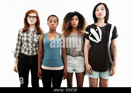 Formal studio portrait of four serious young women - Stock Photo