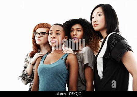 Studio portrait of four serious young women - Stock Photo