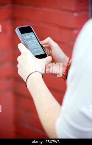 Close up of young woman's hands texting on smartphone - Stock Photo