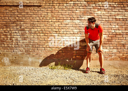Young male runner taking a break - Stock Photo