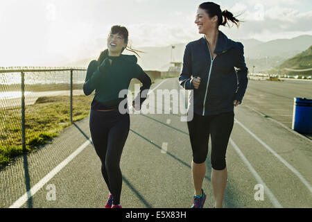 Joggers running on road - Stock Photo