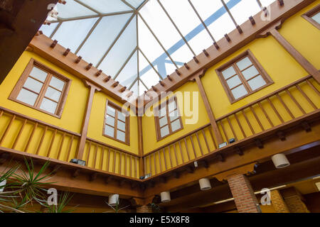 Colorful yellow covered patio and wooden beams - Stock Photo