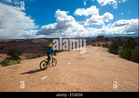 Julien Markewitz Sitting on his Bike During Slick Rock Trail Ride in Moab UT - Stock Photo