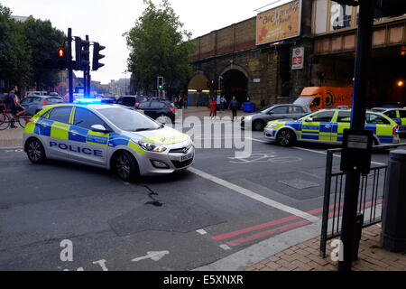 London, UK. 08th Aug, 2014. Police close Kennington Lane and a section of park in Vauxhall after a violent fight - Stock Photo