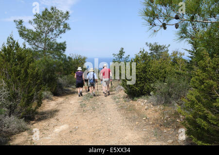 Walkers on a path through Basparmak Mountains towards the coast at Kaplica Bay North Cyprus - Stock Photo