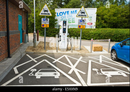 ECOTRICITY electric car recharging point on motorway service station England UK - Stock Photo