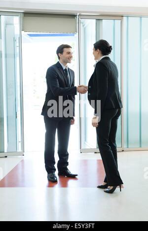 Business associates shaking hands - Stock Photo
