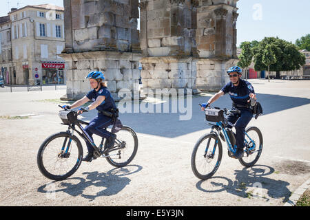 Two French Police Municipale on patrolling on bicycles. - Stock Photo