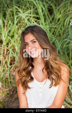 Teenage girl smiling - Stock Photo
