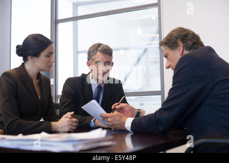 Business meeting, business associates reviewing document - Stock Photo