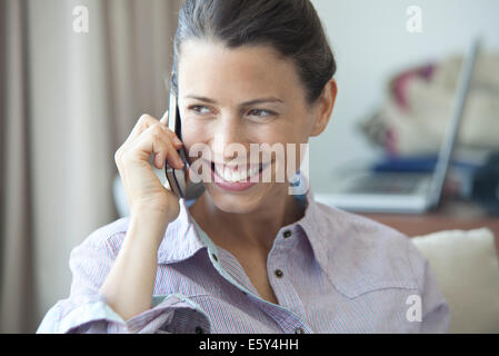 Woman enjoying cell phone conversation - Stock Photo