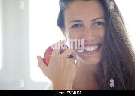 Woman holding apple, portrait - Stock Photo