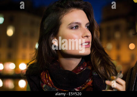 Woman enjoying smoke outdoors - Stock Photo