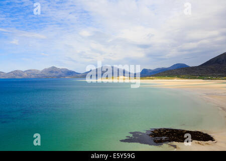 View across Sound of Taransay and Traigh Sheileboist beach to mountains of north Harris Outer Hebrides Western Isles - Stock Photo