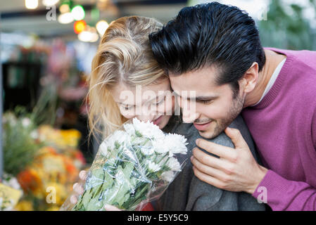 Young couple with flower bouquet - Stock Photo