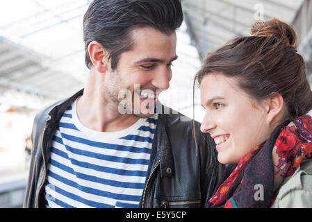 Young couple together on train platform - Stock Photo