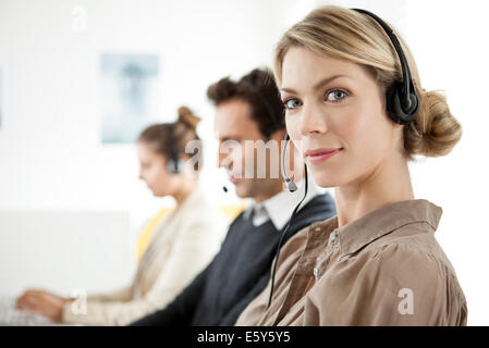 Customer service agent working in call center - Stock Photo