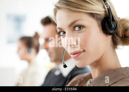Telemarketer working in call center - Stock Photo