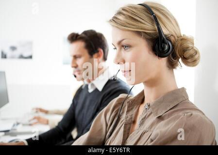 Call center saleswoman on phone call - Stock Photo