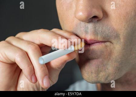 Man smoking electonic cigarette, cropped - Stock Photo