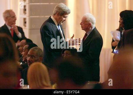 Washington, DC. 5th Aug, 2014. United States Secretary of State John Kerry (L) talks with former President Jimmy - Stock Photo