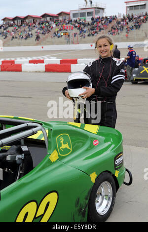 Kelsey Toth by her vehicle at the Auto Clearing Motor Speedway racing circuit in Saskatoon, Saskatchewan, Canada. - Stock Photo